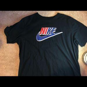 Black Nike T shirt with black and blue Nike logo